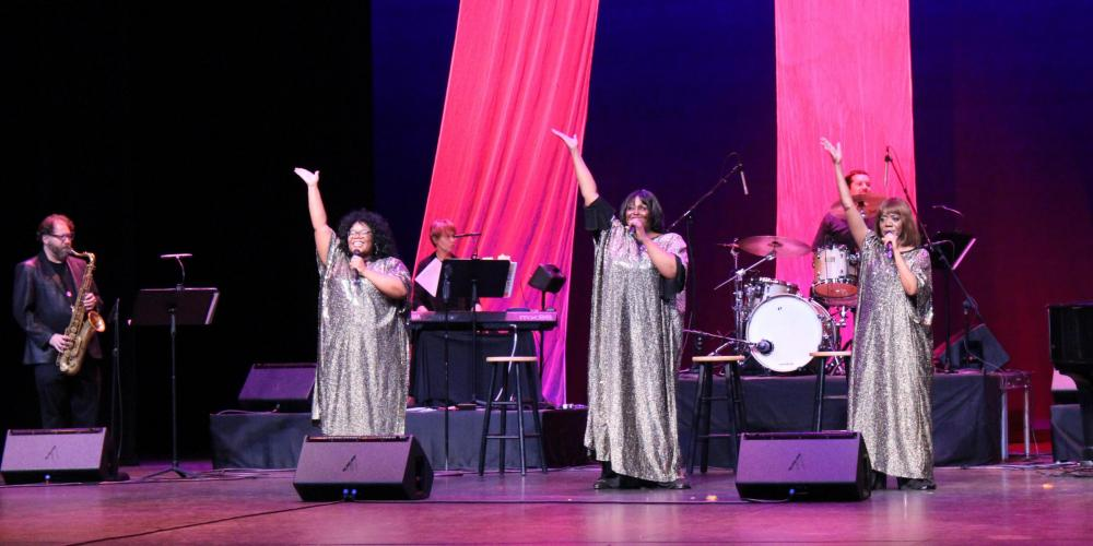 The Legendary Ladies of Soul trio sings on the CCA mainstage in front of the band in shimmering disco gowns.the