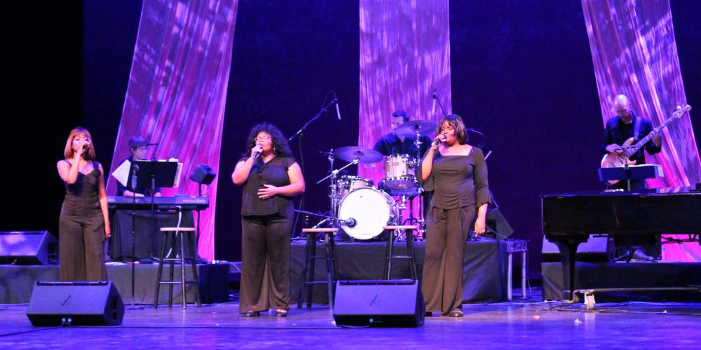 The Legendary Ladies of Soul trio sings on the CCA mainstage in front of the band in black gowns