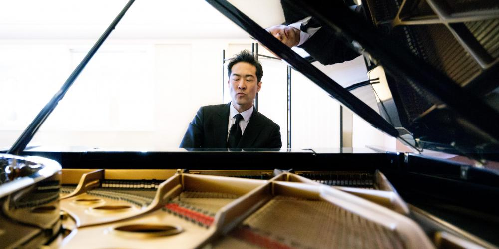 Alpin Hong performs for students at Chandler Center for the Arts