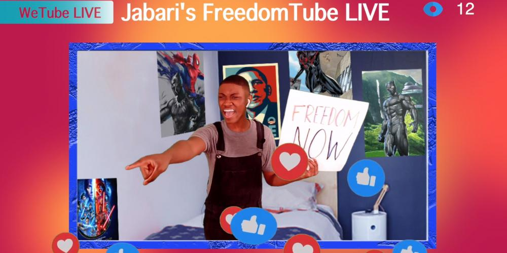 "Image of Jabari - a young boy - in his room holding a sign that says ""Freedom Now"""