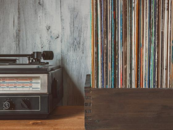 Honoring the more than 400 songs written by Carole King the photo shows a box of records and a record player