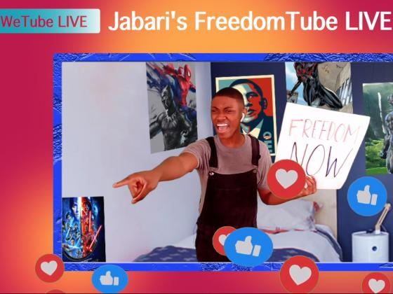 """Image of Jabari - a young boy - in his room holding a sign that says """"Freedom Now"""""""