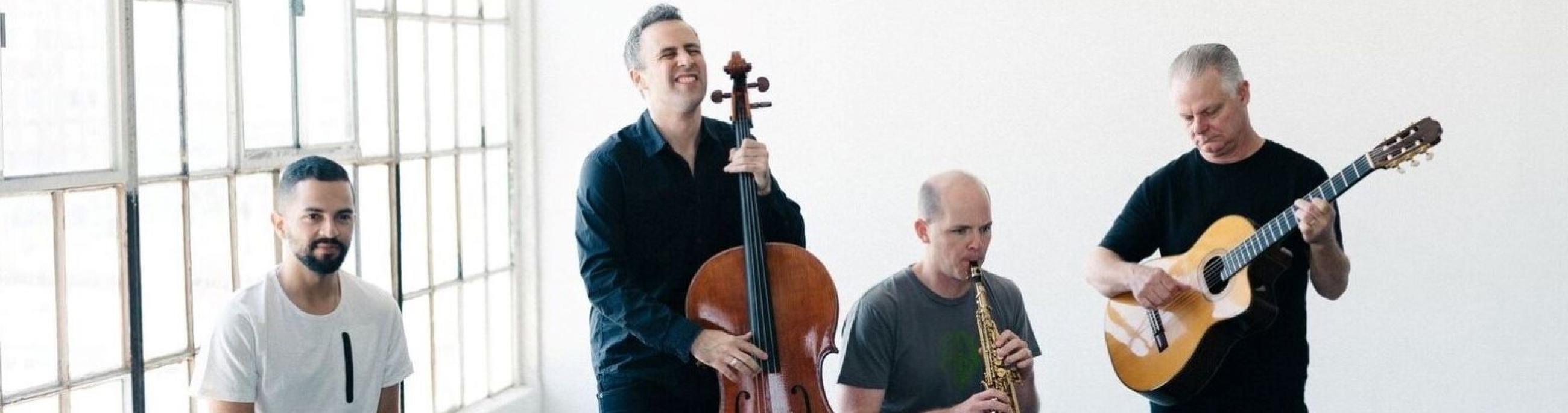 Four members of Quarteto Nuevo perform in a bright, airy industrial loft.