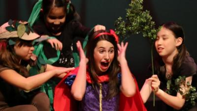 """Children perform """"Snow White"""" in costume at a CCA Kids Camp."""