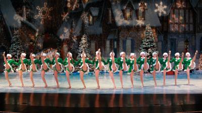 Spirit of Christmas dancers in a kick line.