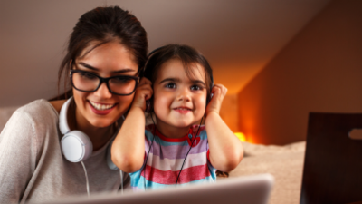 A mother and daughter engaging in an onscreen activity